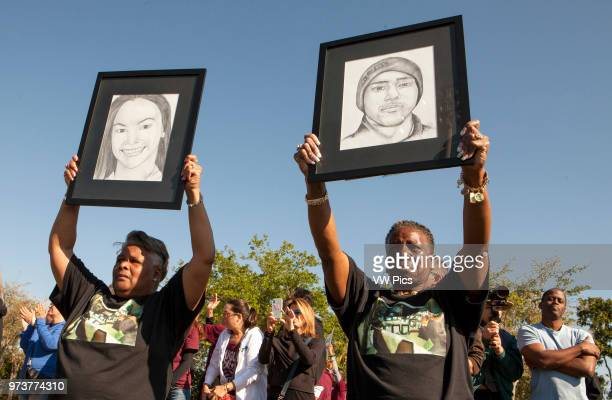 Emotional Pat Gibson left and Valerie Davis hold signs of two of the victims killed in the Parkland shooting during the onemonth anniversary outside...