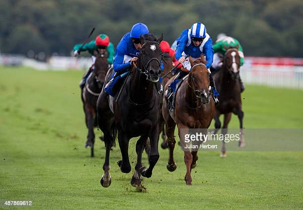 Emotionless ridden by William Buick leads the field home to win The At The Races Champagne Stakes Race run at Doncaster Racecourse on September 12...