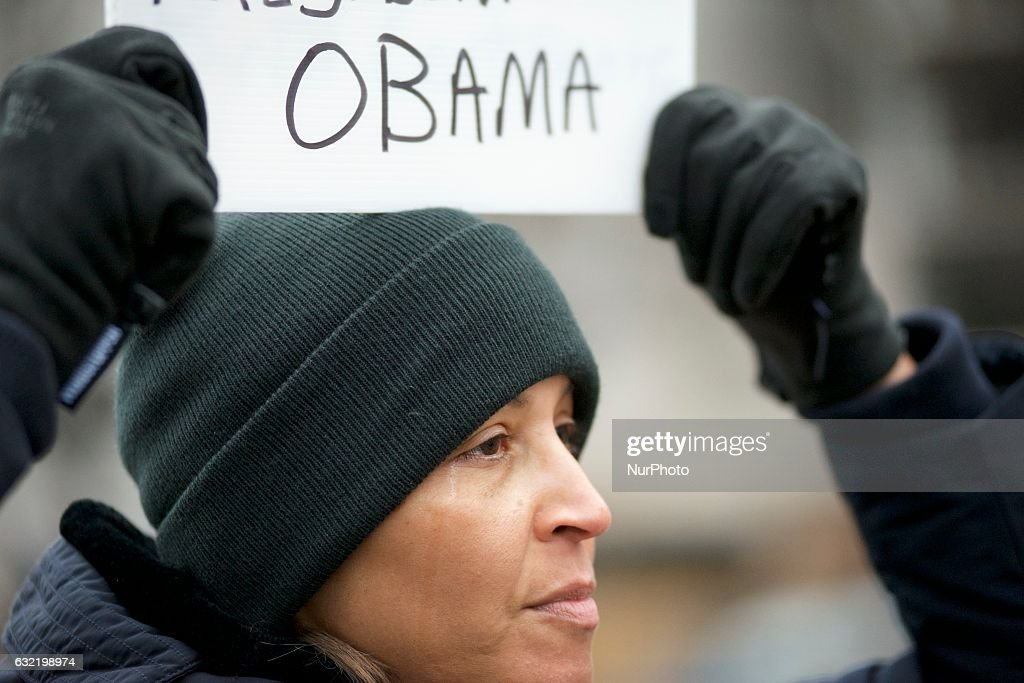 Emotions overwhelm Ella Johnson, of Los Angeles, CA, as she stands along the Parade Route, in support of outgoing President Barack Obama, on Jan. 20th 2017, in Washington D.C.