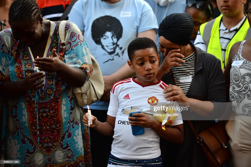 Emotions run high as people attend a candle lit vigil outside Notting Hill Methodist Church near the 24 storey residential Grenfell Tower block in Latimer Road, West London on June 14, 2017 in London, England. The Mayor of London, Sadiq Khan, has declared the fire a major incident as more than 200 firefighters are still tackling the blaze, while at least 50 people are receiving hospital treatment.