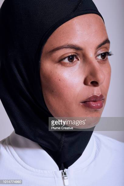 Emotive close up portrait of woman wearing sportswear and hijab