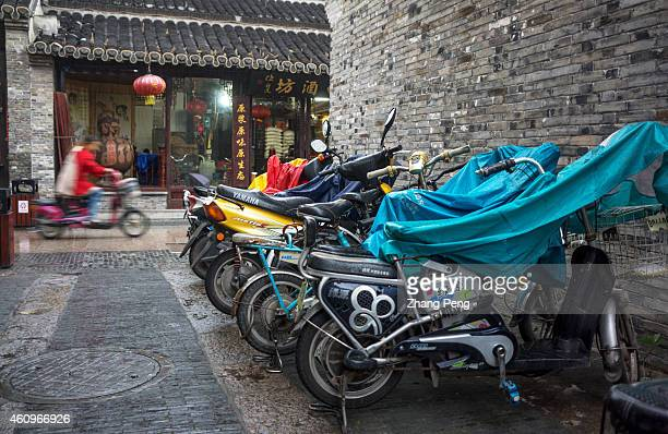 Emotorcycles parked in the alley of an ancient street China now has in excess of 130 million ebikes on its town and city roads creating enormous...