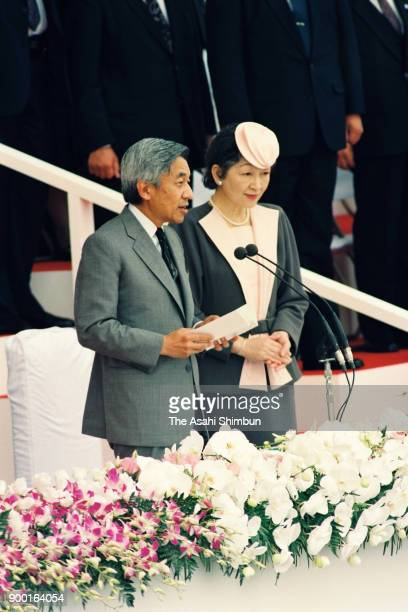 Emperor Akihito addresses Empress Michiko listens during the opening ceremony of the national sports festival Yamagata Prefecture Athletic Stadium on...