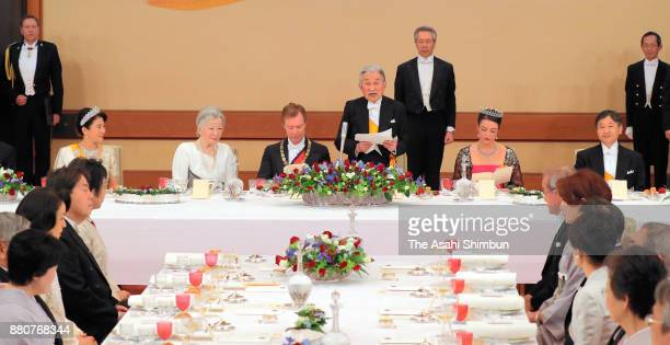 Emperor Akihito addresses while Grand Duke Henri of Luxembourg his daughter Princess Alexandra of Luxembourg and Empress Michiko listen during the...