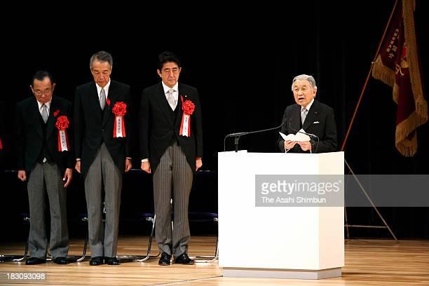 Emperor Akihito addresses while Prime Minister Shinzo Abe Speaker of the House of Representatives Bunmei Ibuki and President of the House of...