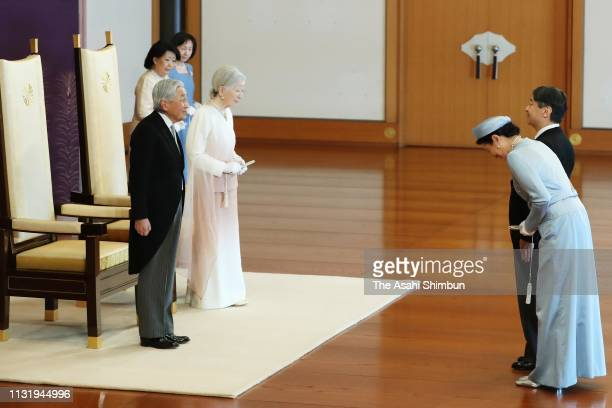 Emperor Akihito along with Empress Michiko is greeted by Crown Prince Naruhito and Crown Princess Masako during the ceremony marking the 30th...