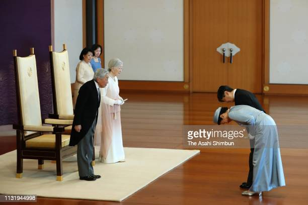 Emperor Akihito, along with Empress Michiko, is greeted by Crown Prince Naruhito and Crown Princess Masako during the ceremony marking the 30th...