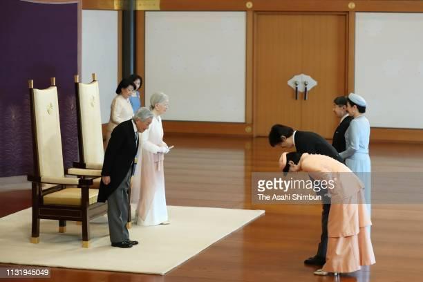Emperor Akihito, along with Empress Michiko, is greeted by Crown Prince Naruhito, Crown Princess Masako, Prince Akishino and Princess Kiko of...