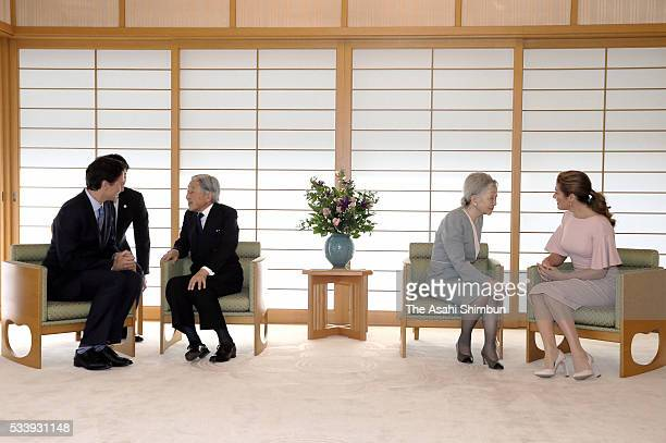 Emperor Akihito and Canadian Prime Minister Justin Trudeau talk while Empress Michiko and Sophie Gregoire-Trudeau talk during their meeting at the...