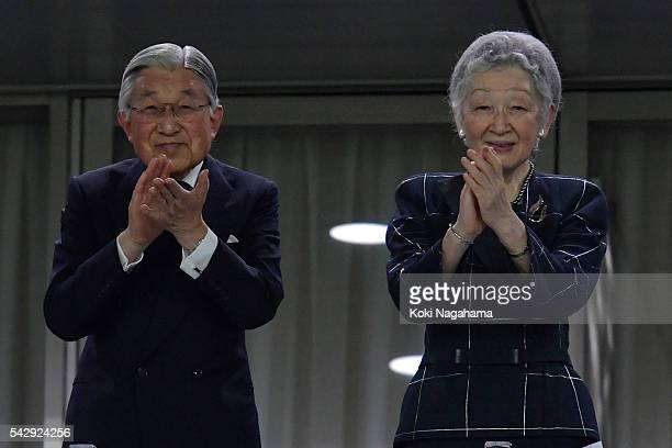 Emperor Akihito and Empress Michiko applaud players during the international friendly match between Japan v Scotland at Ajinomoto Stadium on June 25...