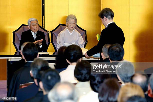 Emperor Akihito and Empress Michiko applaude poet Gozo Yoshimatsu who won the Imperial Prize during the Japan Art Academy award ceremony at the Japan...