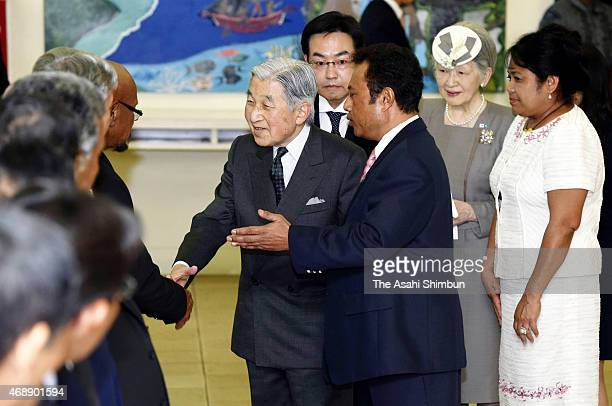Emperor Akihito and Empress Michiko are escorted by Palau President Tommy Remengesau and his wife Debbie upon arrival at the Palau International...
