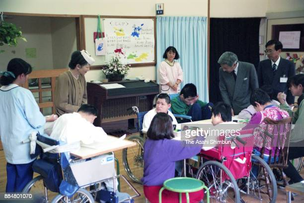 Emperor Akihito and Empress Michiko are seen during their visit to a center for handicapped on October 27 1994 in Kusatsu Shiga Japan