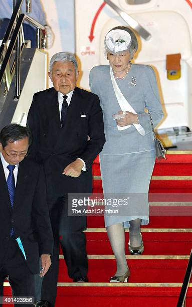 Emperor Akihito and Empress Michiko are seen on arrival at Haneda International Airport after their visit to Oita on October 4 2015 in Tokyo Japan