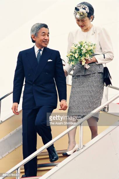 Emperor Akihito and Empress Michiko are seen on arrival at Haneda Airport after visiting Europe on September 19 1993 in Tokyo Japan
