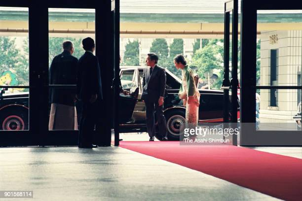 Emperor Akihito and Empress Michiko are seen on arrival at Ryogoku Kokugikan to see sumo bouts during day eight of the Grand Sumo Summer Tournament...
