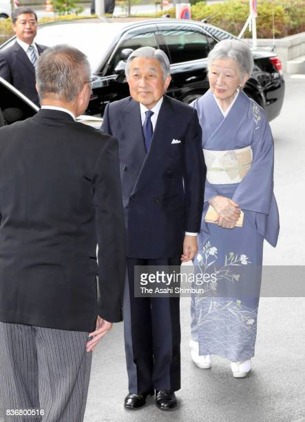 Emperor Akihito and Empress Michiko are seen on arrival at the opening ceremony of the 24th Congress of the International Commission for Optics on...