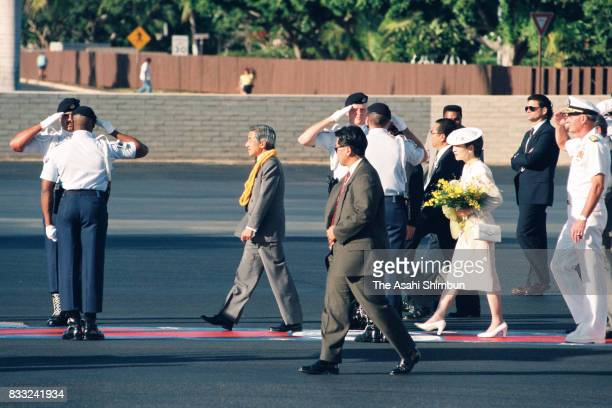 Emperor Akihito and Empress Michiko are seen on arrival at the US Air Force Hickam Field on June 23 1994 in Honolulu Hawaii