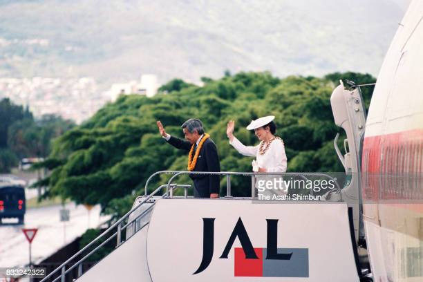 Emperor Akihito and Empress Michiko are seen on departure for Japan at the US Air Force Hickam Field on June 25 1994 in Honolulu Hawaii