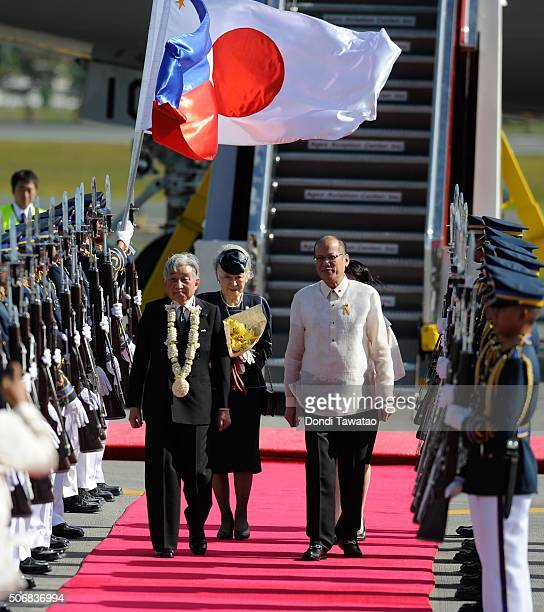 Emperor Akihito and Empress Michiko are welcomed by Philippine president Benigno Aquino during their arrival at Ninoy Aquino International Airport on...