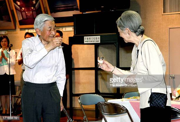 Emperor Akihito and Empress Michiko attend a tea party hosted by the Imperial Household Agency to celebrate Empress' 77th birthday at the Imperial...