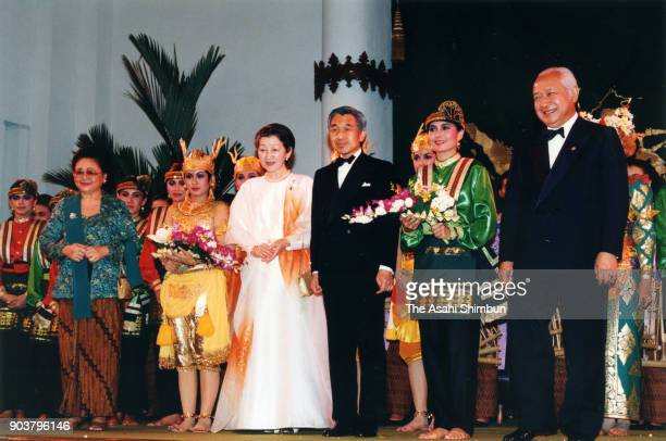 Emperor Akihito and Empress Michiko attend the dinner with Indonesian President Muhammad Suharto and his wife Siti Hartinah at the Merdeka Palace on...