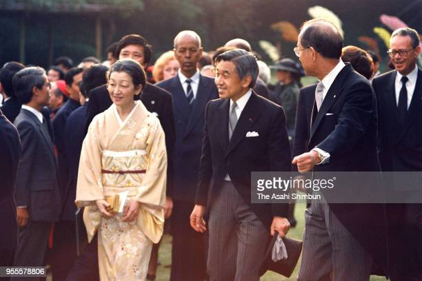 Emperor Akihito and Empress Michiko attend the garden party celebrating his Enthronement at the Akasaka Imperial Garden on November 13 1990 in Tokyo...
