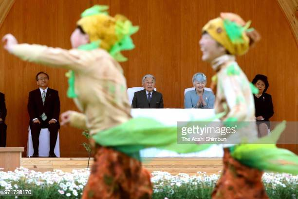 Empress Michiko plants a young tree with a child during the National TreePlanting Festival on June 10 2018 in Minamisoma Fukushima Japan This 3day...