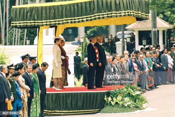Emperor Akihito and Empress Michiko attend the welcome ceremony with Indonesian President Muhammad Suharto and his wife Siti Hartinah at the Merdeka...