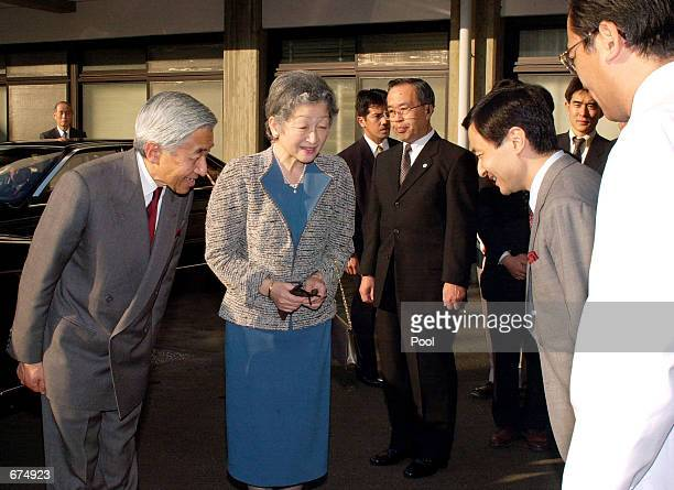 Emperor Akihito and Empress Michiko bow as they meet with Crown Prince Naruhito after the couple visited the Imperial Household Agency Hospital to...