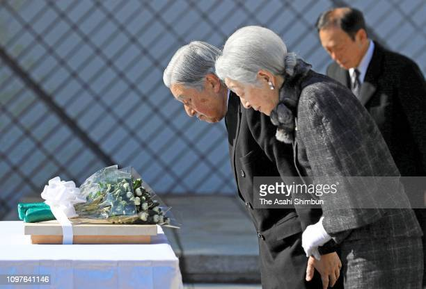 Emperor Akihito and Empress Michiko bow at a cenotaph for the died sailors of commercial and fishery vessels during the WWII at Kannonzaki Park on...