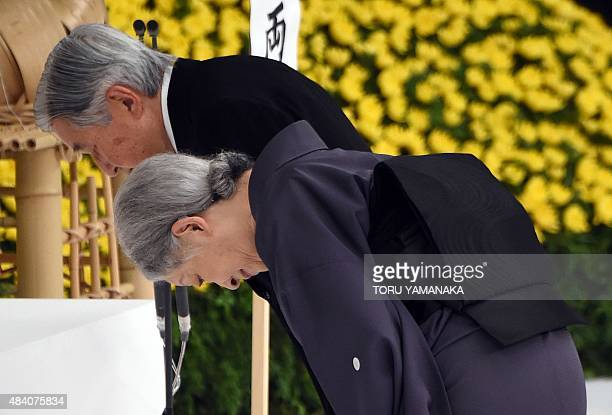 Emperor Akihito and Empress Michiko bow before the altar during the annual memorial service for war victims in Tokyo on August 15 2015 Japan's...