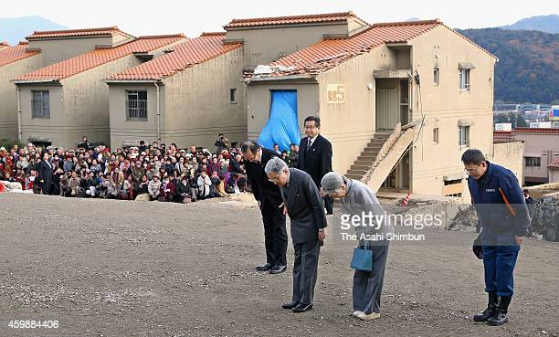 Emperor Akihito and Empress Michiko bow during their visit to a disasterstricken district on December 3 2014 in Hiroshima Japan The district was...