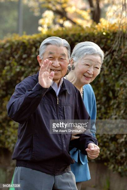 Emperor Akihito and Empress Michiko go for a walk outide the Imperial Palace to wiew cherry trees on April 2 2018 in Tokyo Japan