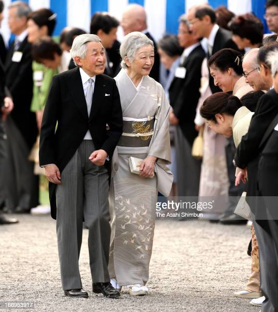 Emperor Akihito and Empress Michiko greet to the guests during the annual spring garden party at Akasaka Palace on April 18 2013 in Tokyo Japan
