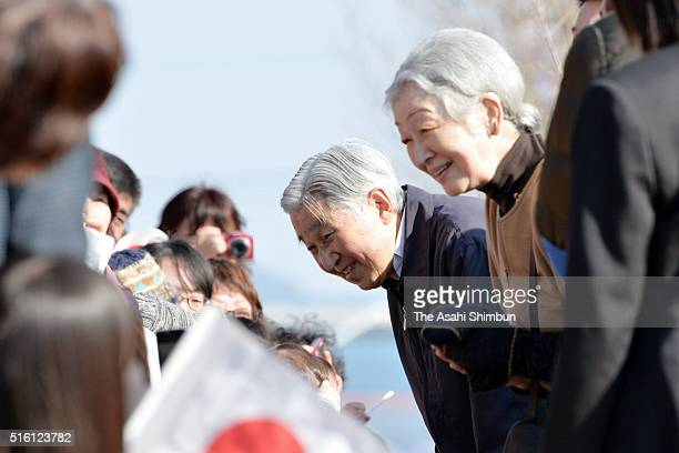 Emperor Akihito and Empress Michiko greet wellwishers at a commercial complex 'Seapal Pier' on March 17 2016 in Onagawa Miyagi Japan The imperial...