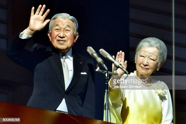 Emperor Akihito and Empress Michiko greet well-wishers from a balcony at the Imperial Palace on January 2, 2018 in Tokyo, Japan.