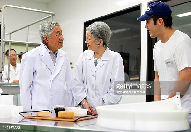 Emperor Akihito and Empress Michiko inspect a cheese factory on July 23, 2012 in Nasu, Japan.