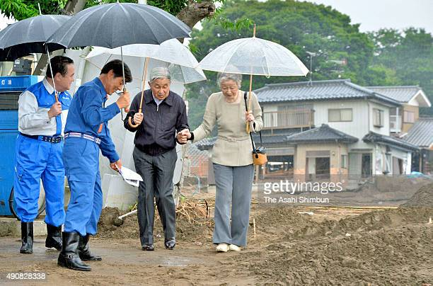 Emperor Akihito and Empress Michiko inspect the area devastated by the flood on October 1 2015 in Joso Ibaraki Japan