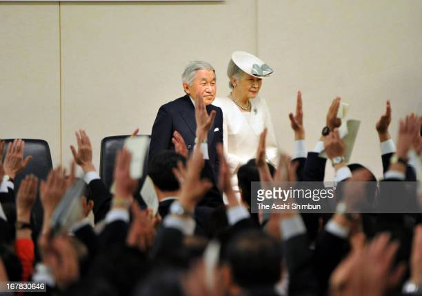 Emperor Akihito and Empress Michiko leave while attendees make banzai cheers during the ceremony of the restoration of sovereignty at Kensei Kinen...