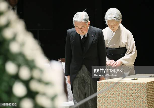 Emperor Akihito and Empress Michiko observe a minute of silence on 246pm at the national memorial service at the National Theatre on the fourth...