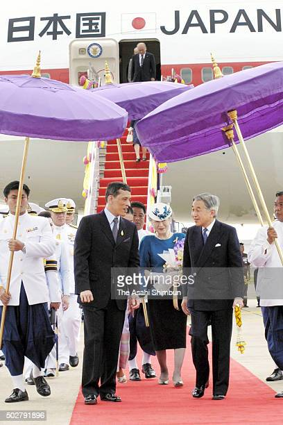 Emperor Akihito and Empress Michiko of Japan are welcomed by Crown Prince Maha Vajiralongkorn of Thailand on arrival at the Don Mueang International...