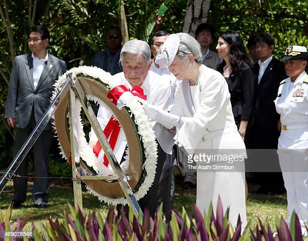 Emperor Akihito and Empress Michiko offer a wreath at a monument for the 81st Infantry Division of the U.S. Army on April 9, 2015 in Peleliu Island,...