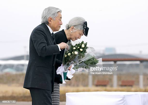 Emperor Akihito and Empress Michiko offer flowers at an altar set in front of the monument to commemorate the victims of the Great East Japan...