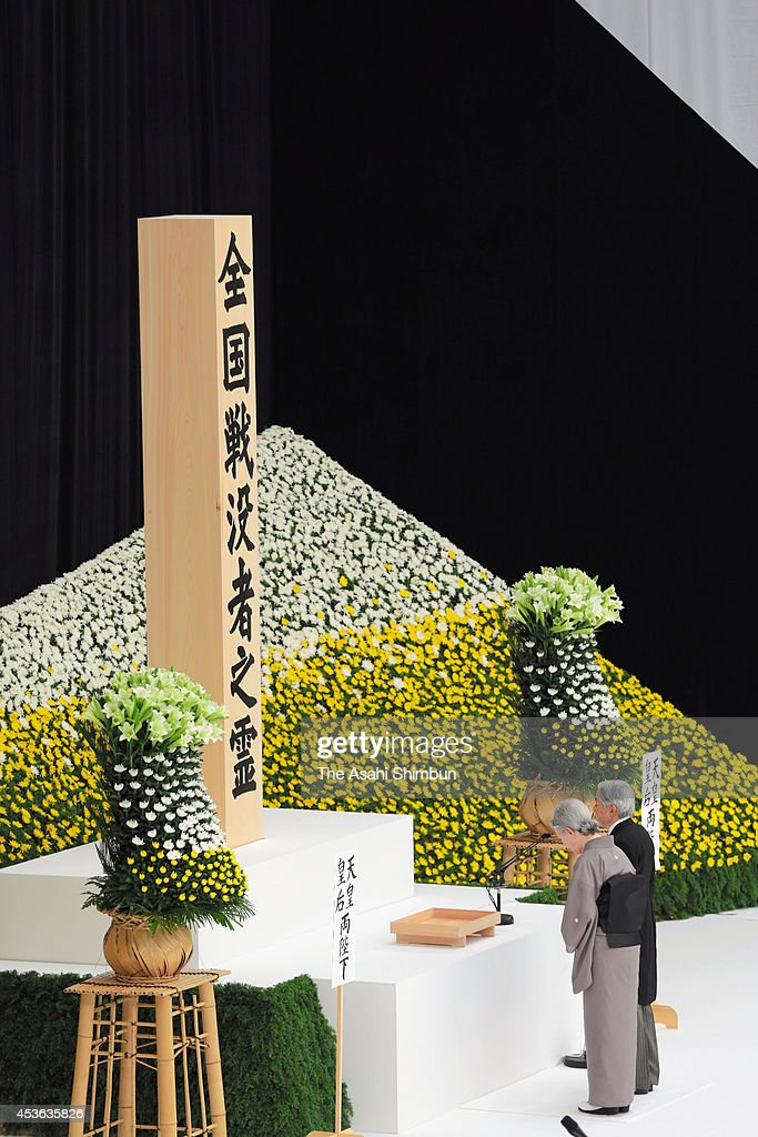 Emperor Akihito and Empress Michiko offer prayers to the war dead at a ceremony marking the 69th anniversary of the end of World War II at Nippon Budokan hall on August 15, 2014 in Tokyo, Japan. Japan marks the 69th anniversary of the end of World War II in Asia today, following their surrender on August 15 in 1945.