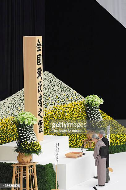 Emperor Akihito and Empress Michiko offer prayers to the war dead at a ceremony marking the 69th anniversary of the end of World War II at Nippon...