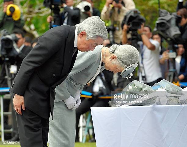 Emperor Akihito and Empress Michiko pay their respects at the cenotaph for Japanese soldiers in the Japanese Memorial Garden on January 29 2016 in...