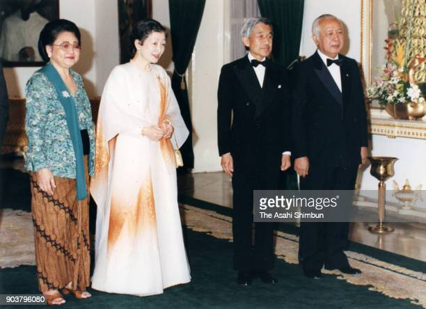 Emperor Akihito and Empress Michiko pose with Indonesian President Muhammad Suharto and his wife Siti Hartinah prior to the dinner at the Merdeka...