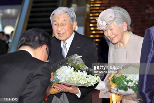 Emperor Akihito and Empress Michiko receive flower bouquets after the ceremony marking the 30th anniversary of the enthronement at the National...