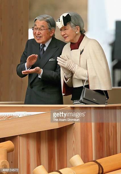 Emperor Akihito and Empress Michiko release young trout into Otaki Ryujin Lake during a fishery industry promotional event on November 16 2014 in...